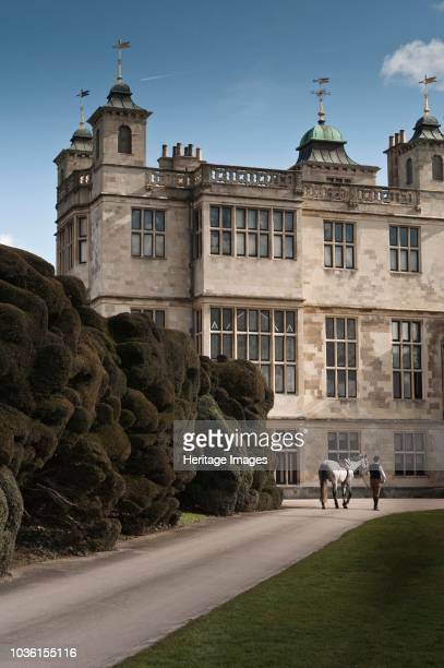 Reenactor dressed as the stable master leading a horse up the drive towards Audley End House Saffron Walden Essex 2010 Audley End House stands on the...