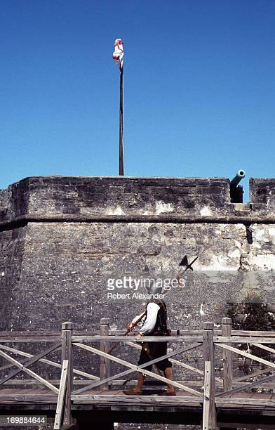 A reenactor dressed in a 17th century Spanish miliary uniform approaches the entrance to the 17th century Spanish fort Castillo de San Marcos in St...