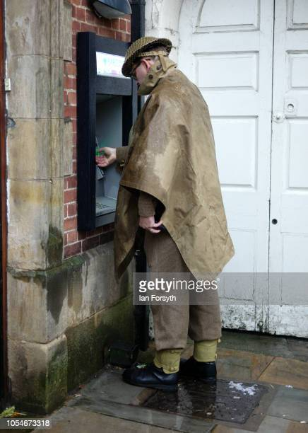 A reenactor dressed in a British Army uniform uses the cash machine during the North Yorkshire Moors Railway 1940's Wartime Weekend event on October...
