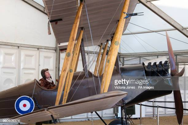A reenactor looks at a BE2c First World War bomber biplane on show at Horse Guards Parade in London as part of the National Aircraft Tour to mark 100...