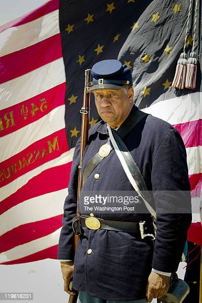 Reenactor Mel Reid with the 54th Regiment Massachusetts Volunteer Infantry before the start of ceremonies to honor the anniversary of the historic...