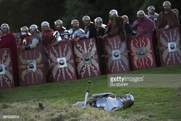 A reenactor portraying a soldier from the Imperial Roman Army plays dead following a battle with Caledonian barbarians during English Heritage's...