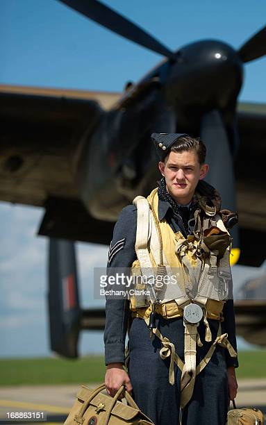 WWII reenactor poses for a photo in front of a WWII Lancaster bomber at RAF Scampton on May 16 2013 in Lincoln England Ladybower and Derwent...