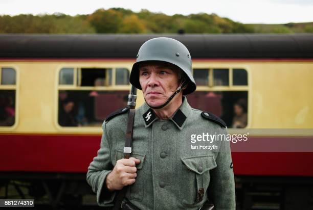 A reenactor wearing German Army uniform stands guard on the platform during the North Yorkshire Moors Railway 1940's Wartime Weekend event on October...