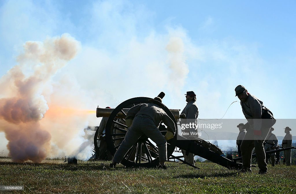 Re-enactors dressed as Confederate soldiers fire a cannon during an event to mark the 150th anniversary of the Battle of Antietam September 15, 2012 in Sharpsburg, Maryland. The Battle of Antietam was fought on September 17, 1862 and was the bloodiest battle in American history with more than 23,000 men killed, wounded, and missing in one single day. It marked the end of General Robert E. Lee's first invasion of the North and led to Abraham Lincoln's issuance of the Emancipation Proclamation.