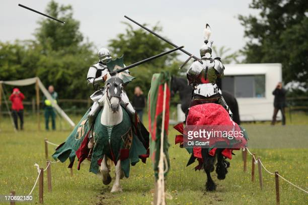 Reenactors dressed as knights stage a medieval jousting competition at Eltham Palace on June 16 2013 in Eltham England The 'Grand Medieval Joust'...
