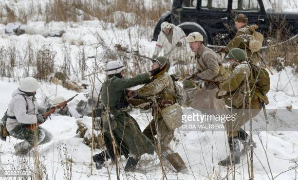 Reenactors dressed as World War II Soviet Red Army soldiers fight against actors dressed as Nazi German troops as they take part the reconstruction...