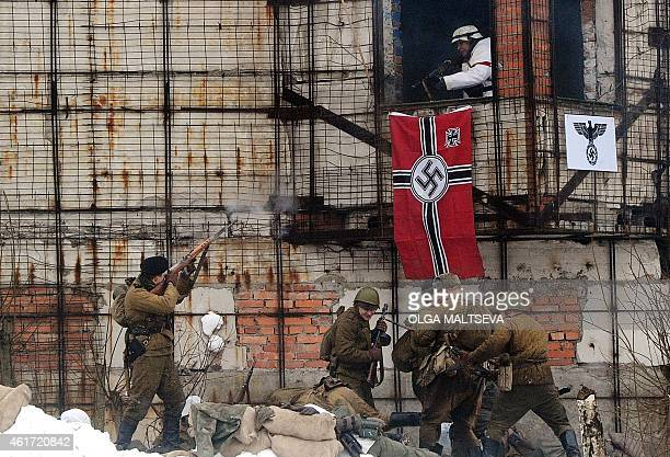 Reenactors dressed as World War II Soviet Red Army's and Nazi Germany's troops take part in battle reconstruction marking the 71st anniversary of the...