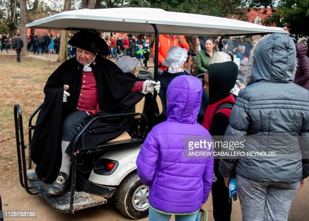 Reenactors drive off in a golf cart after taking part in events as part of Presidents day at George Washingtons' Mount Vernon estate in Mt Vernon...