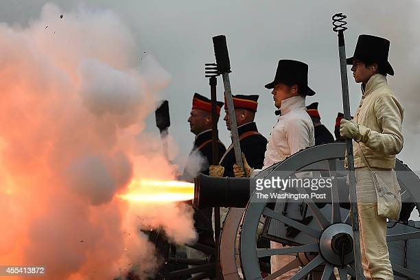 Reenactors fire a cannon during the StarSpangled Spectacular which celebrates the 200th Anniversary of the penning of The StarSpangled Banner and the...