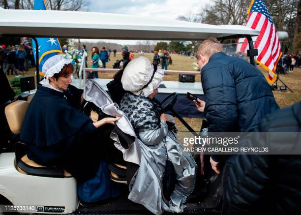 Reenactors get into a golf cart after taking part in events as part of Presidents day at George Washingtons' Mount Vernon estate in Mt Vernon...
