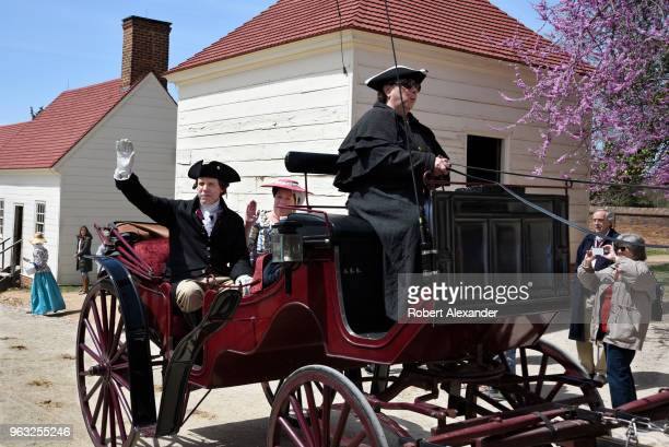 Reenactors in period costumes reenact the 1759 arrival by carriage of Colonel George Washington and his bride Martha and her two young children to...