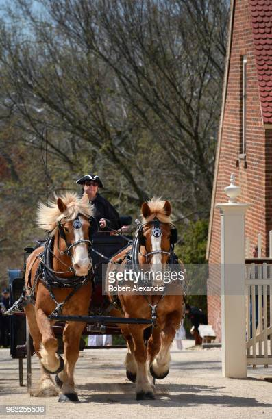 Reenactors in period costumes reenact the 1759 arrival by horsedrawn carriage of Colonel George Washington and his bride Martha and her two young...