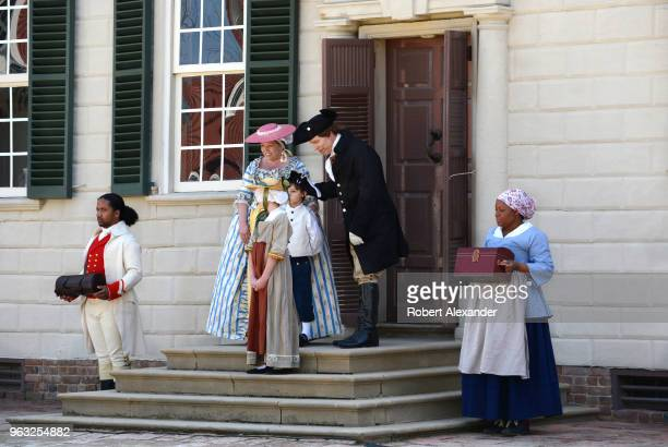 Reenactors in period costumes reenact the 1759 arrival of Colonel George Washington and his bride Martha and her two young children to Washington's...
