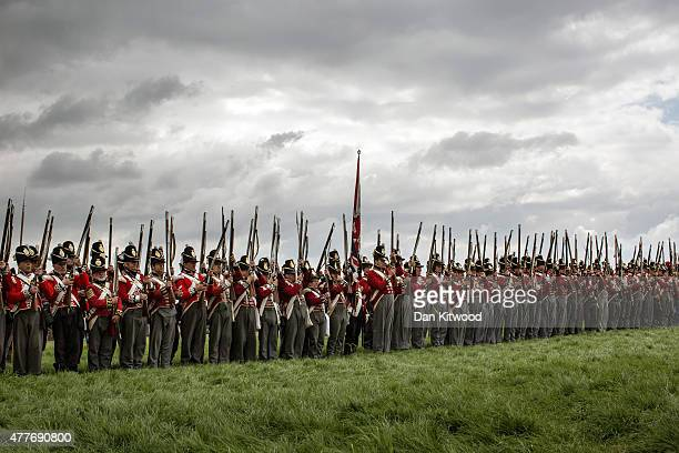 Reenactors in period dress as members of the Allied Army participate in a practice drill on June 19 2015 in Waterloo Belgium Around 5000 historical...
