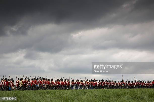 Re-enactors in period dress as members of the Allied Army participate in a practice drill on June 19, 2015 in Waterloo, Belgium. Around 5000...