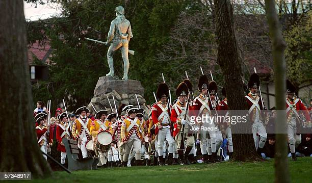 Re-enactors of the Battle of Lexington dressed as British soldiers march in formation as they prepare to fight the Lexington militia April 17, 2006...