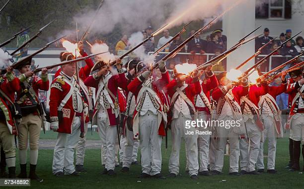 Re-enactors of the Battle of Lexington dressed as British soldiers fire their weapons as they battle with the Lexington militia April 17, 2006 in...