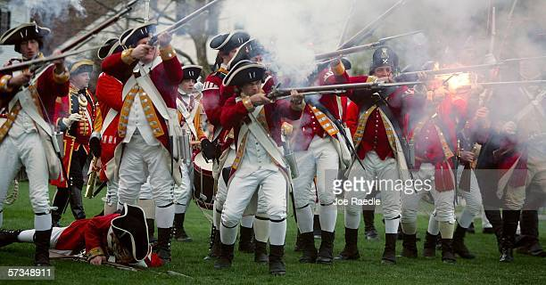 Reenactors of the Battle of Lexington dressed as British soldiers fire their weapons as they battle with the Lexington militia April 17 2006 in...