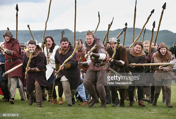 Reenactors playing the part of Scottish soldiers rehearse for the Battle of Bannockburn Live event on June 27 2014 in Stirling Scotland The 700th...