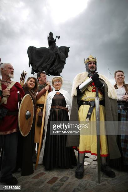 Reenactors playing the parts of Robert the Bruce and his Scottish soldiers pose for photographs at the Bannockburn Live event on June 28 2014 in...