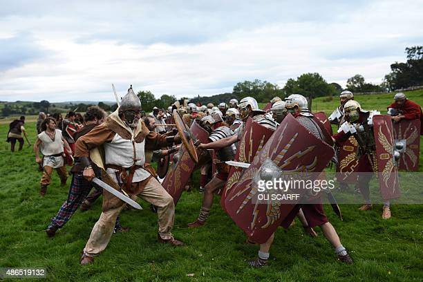 Reenactor's portraying soldiers from the Imperial Roman Army battle with Caledonian barbarians ahead of English Heritage's history weekend Hadrians...