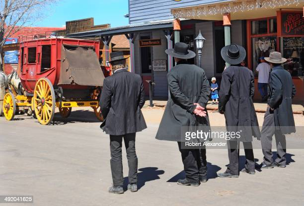 Reenactors portraying Wyatt Earp, his brothers Morgan and Virgil Earp, and Doc Holliday prepare for a gunfight in historic Tombstone, Arizona. The...