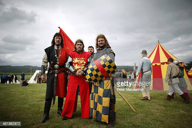 Reenactors pose for a photograph at the Bannockburn Live event on June 28 2014 in Stirling Scotland The 700th anniversary of the historic battle that...