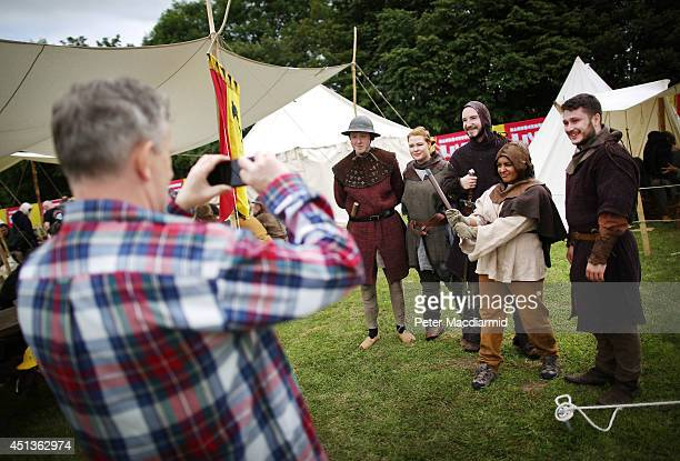 Reenactors pose for photographs at the Bannockburn Live event on June 28 2014 in Stirling Scotland The 700th anniversary of the historic battle that...