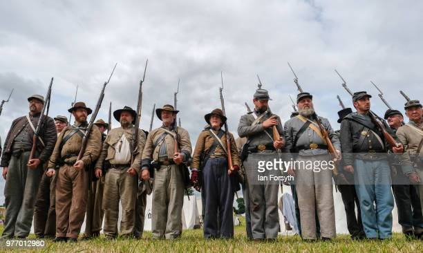 Reenactors representing Confederate soldiers in the American Civil War practice their rifle drill during the Frontline Sedgefield living history...