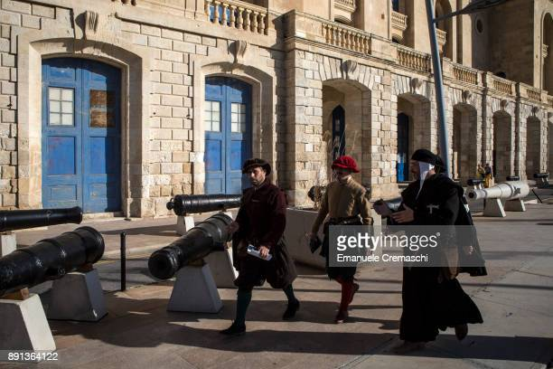 Reenactors stroll on the Grand Harbour Marina on December 7 2017 in Vittoriosa Malta Valletta a fortified town that dates back to the 16th century is...