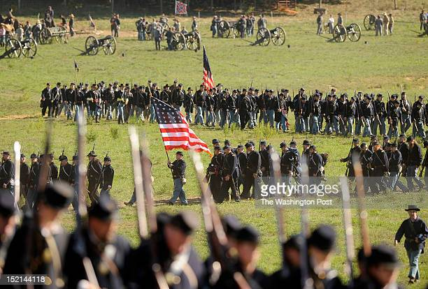Reenactors take part in a recreation entitled Dunker Church as people gather to mark the 150th anniversary of the Battle of Antietam on Saturday...