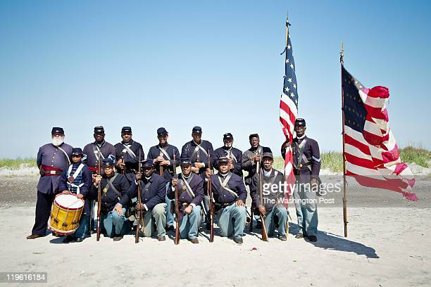 Reenactors with the 54th Regiment Massachusetts Volunteer Infantry pose for photos after ceremonies to honor the anniversary of the historic 1863...