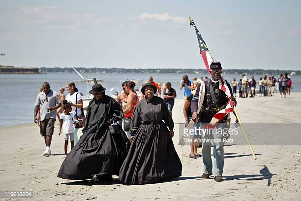 Reenactors with the 54th Regiment Massachusetts Volunteer Infantry and guest arrive after traveling by boat to Morris Island to honor the anniversary...