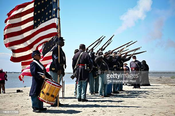 Reenactors with the 54th Regiment Massachusetts Volunteer Infantry fire muskets during ceremonies to honor the anniversary of the historic 1863 Civil...
