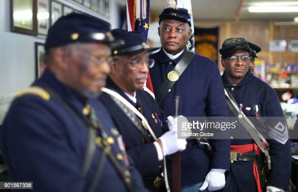 Reenactors with the Massachusetts Volunteer 54th Regiment wait to present the colors in a ceremony during a city brunch honoring AfricanAmerican...