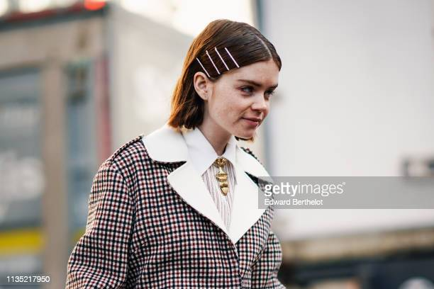 Reese Blutstein wears hairpins a necklace a red white and black checkered jacket with a white collar outside Chloe during Paris Fashion Week...