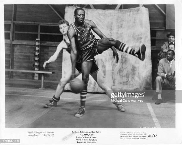 Reese 'Goose' Tatum of the Harlem Globetrotters dribbles the ball during the motion picture 'Go Man Go' circa 1954