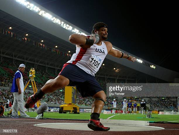 Reese Hoffa of the United States of America competes on his way to finishing first during the Men's Shot Put on day one of the 11th IAAF World...