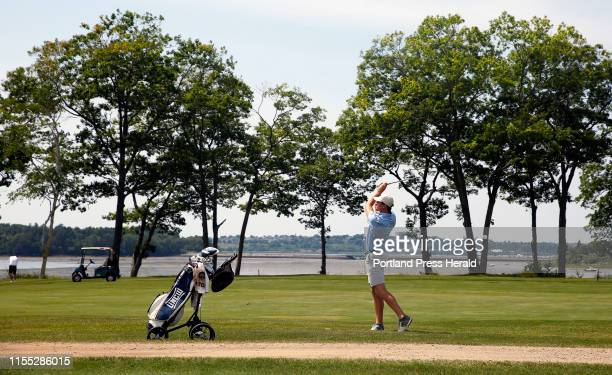 Reese McFarlane swings out of the rough during firstround play from Maine Amateur golf championship at Portland Country Club He ended the day with a...