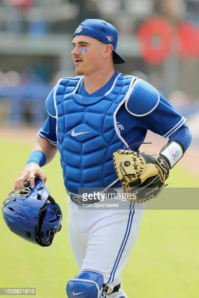 Reese McGuire of the Blue Jays trots out to home plate during the spring training game between the Minnesota Twins and the Toronto Blue Jays on...