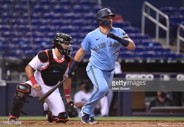 Reese McGuire of the Toronto Blue Jays bats against the Miami Marlins at Marlins Park on September 01, 2020 in Miami, Florida.