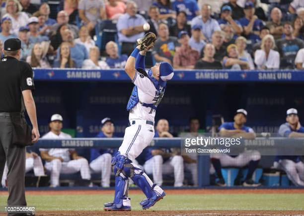 Reese McGuire of the Toronto Blue Jays catches a pop up in the fifth inning during MLB game action against the Cleveland Indians at Rogers Centre on...