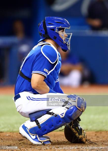 Reese McGuire of the Toronto Blue Jays catches in the eighth inning during a MLB game against the Seattle Mariners at Rogers Centre on August 17,...