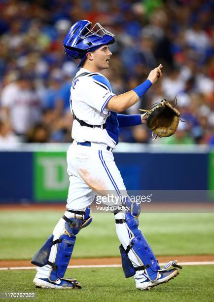 Reese McGuire of the Toronto Blue Jays catches in the sixth inning of a MLB game against the Atlanta Braves at Rogers Centre on August 27, 2019 in...