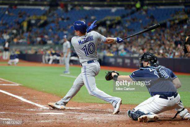 Reese McGuire of the Toronto Blue Jays hits an RBI single in the sixth inning against the Tampa Bay Rays at Tropicana Field on Saturday September 7...