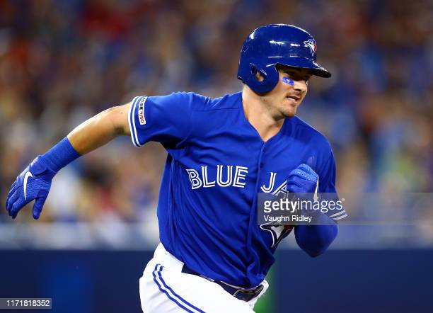 Reese McGuire of the Toronto Blue Jays runs to first base but pops out in the third inning during a MLB game against the Houston Astros at Rogers...