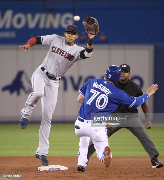 Reese McGuire of the Toronto Blue Jays steals second base in the third inning on the errant throw to Erik Gonzalez of the Cleveland Indians at Rogers...