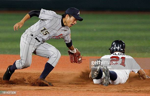 Reese McGuire of United States slides safely into second base past Fumiya Hojo of Japan during the U18 Baseball World Championship match between...