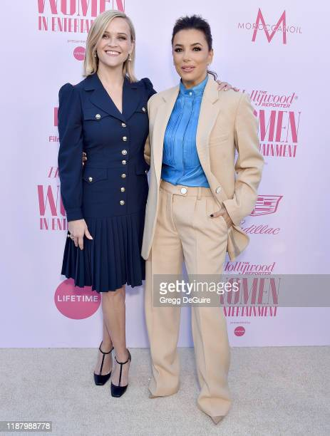 Reese Witherspoon and Eva Longoria arrive at The Hollywood Reporter's Annual Women in Entertainment Breakfast Gala at Milk Studios on December 11,...